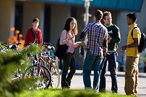 Image of students chatting on Mcmaster Campus